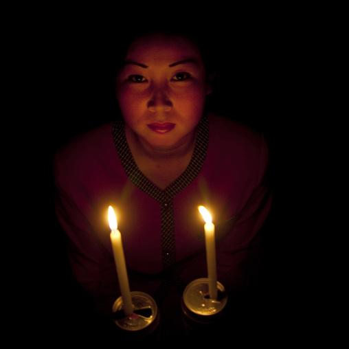 North Korean woman with candles during electricity shortage, North Hamgyong Province, Jung Pyong Ri, North Korea