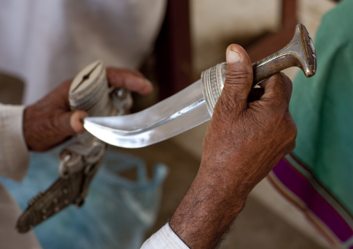 Man Checking A Khanjar, Sinaw, Oman