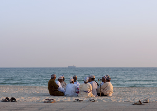 Men In Dishdasha Meeting On The Beach, Salalah, Oman