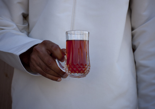 Man Holding A Cup Of Tea During Tea Time, Taqa, Oman