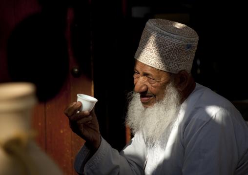 Old Omani Man In Nishdasha Holding A Cup, Oman