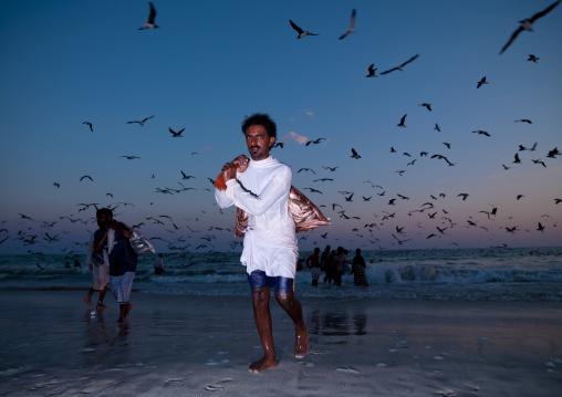 Man Back From Fishing And Taking Fishes Back At Dusk, Salalah, Oman