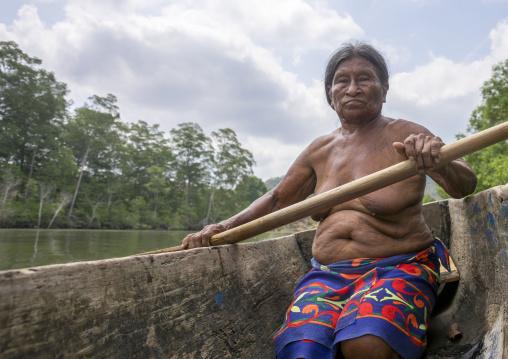 Panama, Darien Province, Puerta Lara, Old Wounaan Tribe Woman Rowing In A Canoe