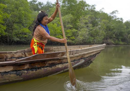 Panama, Darien Province, Puerta Lara, Wounaan Tribe Woman Rowing In A Canoe