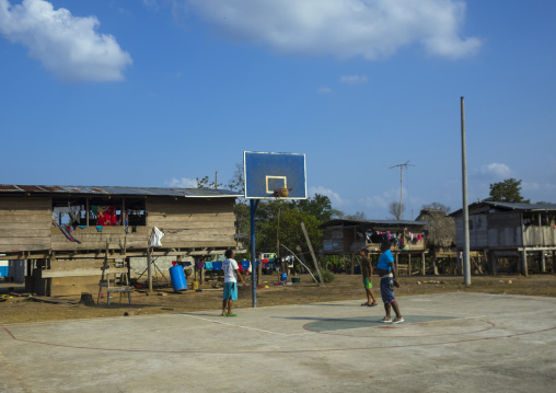 Panama, Darien Province, Alto Playona, Teenagers Playing On A Basketball Playground In An Embera Tribe Village