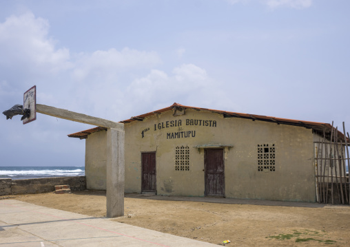 Panama, San Blas Islands, Mamitupu, Basketball Playground In Front Of A Baptist Church In A Kuna Indian Village