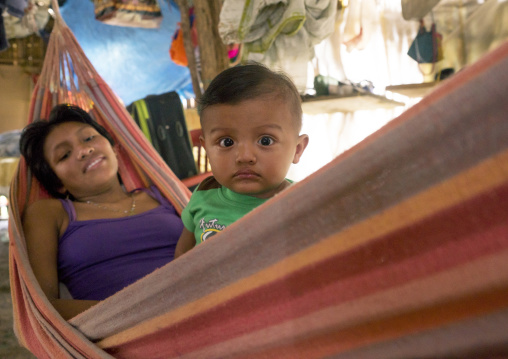 Panama, San Blas Islands, Mamitupu, Portrait Of A Kuna Tribe Mother With Her Baby In A Hammock