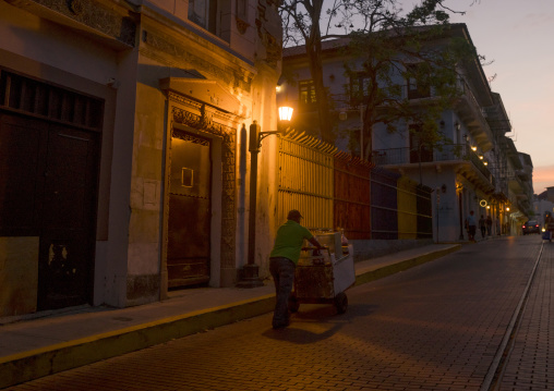 Panama, Province Of Panama, Panama City, Man Passing In The Streets Of Casco Viejo At Sunset