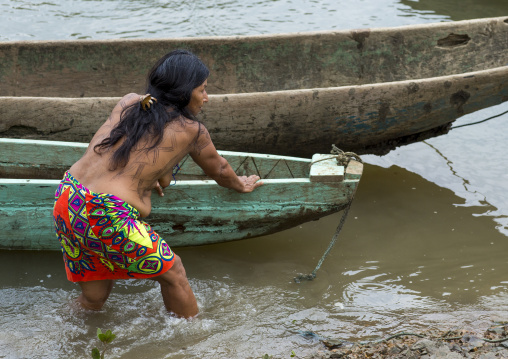 Panama, Darien Province, Puerta Lara, Indigenous Wounaan Woman Sets Out To Go Fishing In Their Dug Out Boat