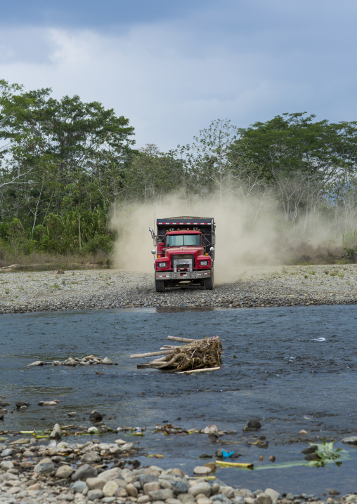 Panama, Darien Province, Bajo Chiquito, Logging Truck Crossing A River With Trunks