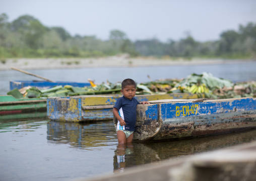 Panama, Darien Province, Bajo Chiquito, Embera Tribe Child Dressed In Western Clothes In A River