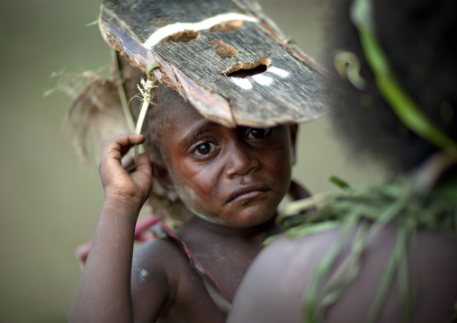 Portrait of a boy crying during Malagan tatuana masks dance, New Ireland Province, Langania, Papua New Guinea