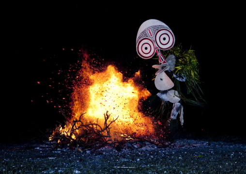 Dancer with a giant mask during a Baining tribe fire dance, East New Britain Province, Rabaul, Papua New Guinea