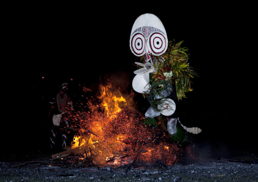 Dancer with a giant mask during a Baining tribe fire ceremony, East New Britain Province, Rabaul, Papua New Guinea