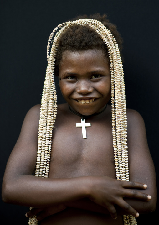 Girl holding a giant shell money, East New Britain Province, Rabaul, Papua New Guinea
