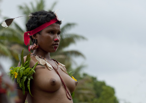 Portrait of a topless tribal woman in traditional clothing, Milne Bay Province, Trobriand Island, Papua New Guinea