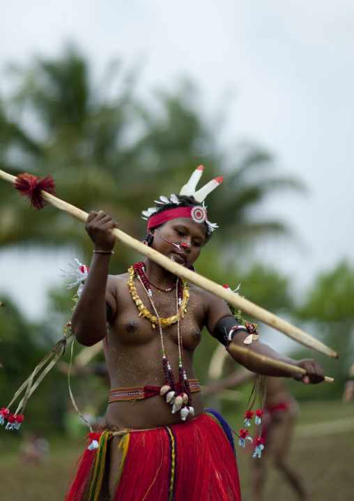 Portrait of a tribal woman in traditional clothing, Milne Bay Province, Trobriand Island, Papua New Guinea