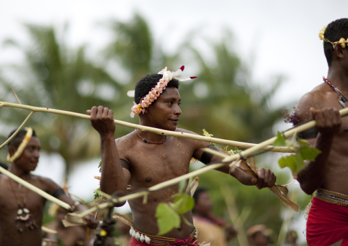 Tribal dancers in traditional clothing during a ceremony, Milne Bay Province, Trobriand Island, Papua New Guinea