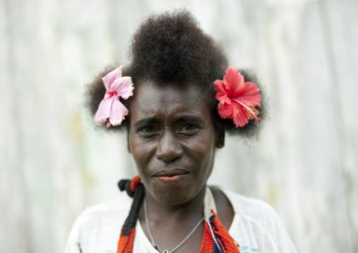 Portrait of a woman wearing flowers in the hair, Autonomous Region of Bougainville, Bougainville, Papua New Guinea