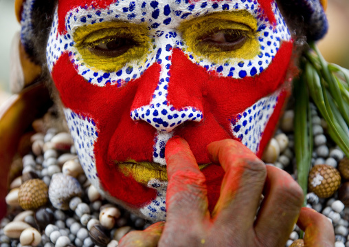 Portrait of a Highlander woman makeup during a sing-sing, Western Highlands Province, Mount Hagen, Papua New Guinea
