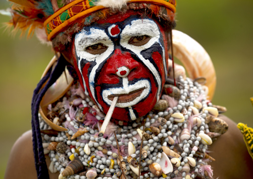 Portrait of a Highlander woman smoking during a sing-sing, Western Highlands Province, Mount Hagen, Papua New Guinea