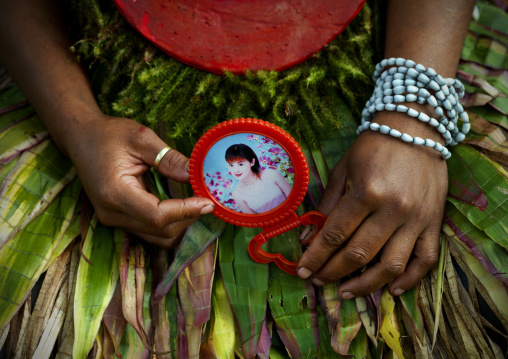 Highlander woman with a chinese mirror during a sing-sing, Western Highlands Province, Mount Hagen, Papua New Guinea