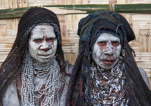 Mourning women with job tears necklaces, Western Highlands Province, Mount Hagen, Papua New Guinea