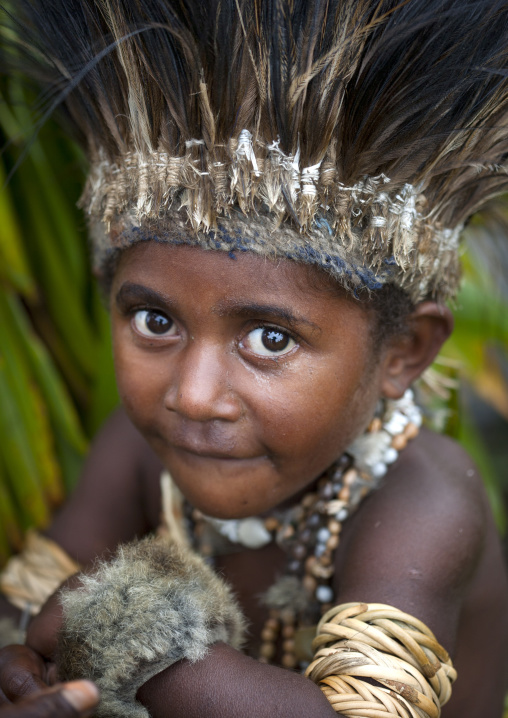 Chimbu tribe boy with a feathers headwear during a Sing-sing ceremony, Western Highlands Province, Mount Hagen, Papua New Guinea