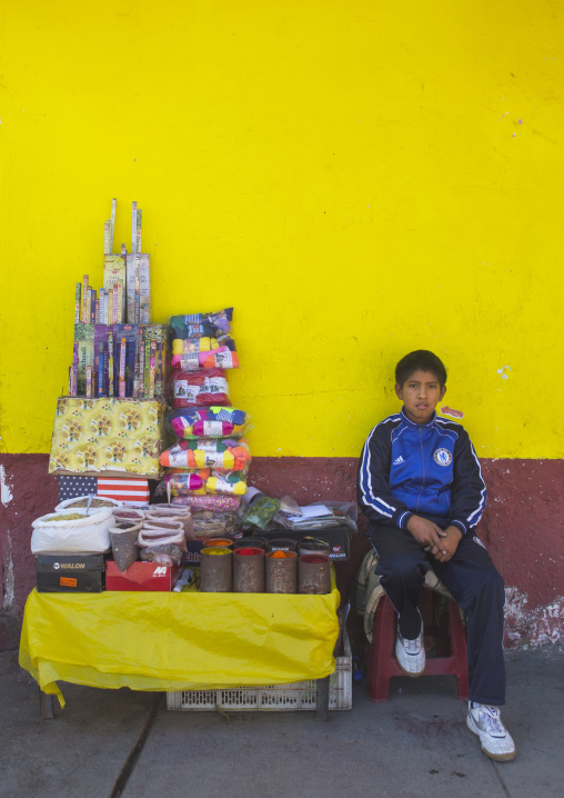 Child Selling Food In The Street, Cuzco, Peru