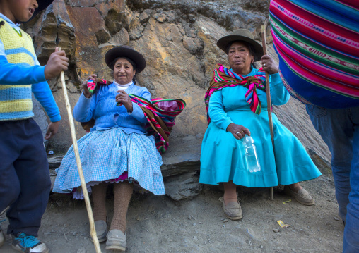Old Peruvian Woman Resting On The The Way To Qoyllur Riti Festival, Ocongate Cuzco, Peru