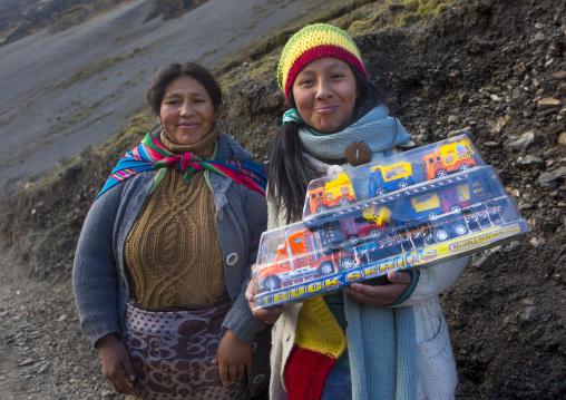 Women With A Toy Truck Bought During Qoyllur Riti Festival, Ocongate Cuzco, Peru