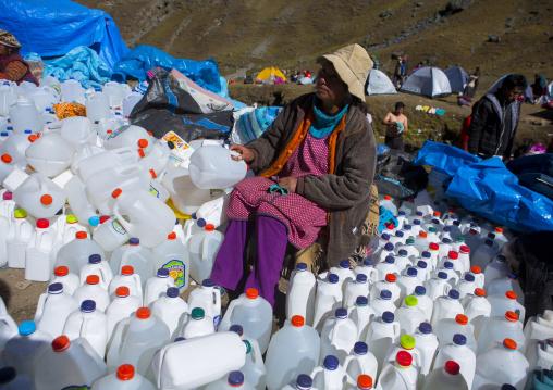 Woman Selling Holly Water At Qoyllur Riti Festival, Ocongate Cuzco, Peru
