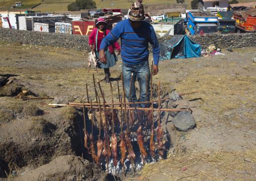 Man Cooking Cuys, Qoyllur Riti, Ocongate Cuzco, Peru