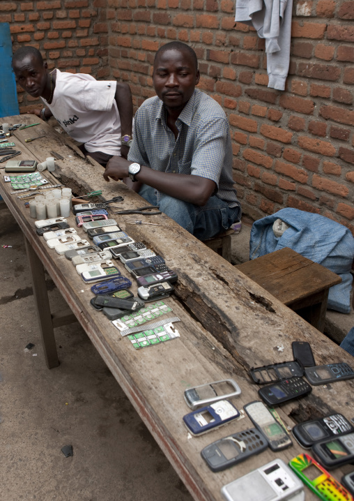 Rwandan man repairing mobile phones in the market, Lake Kivu, Gisenye, Rwanda