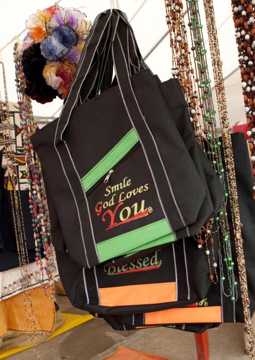 Bags with religious logo for sale in the market, Lake Kivu, Gisenye, Rwanda
