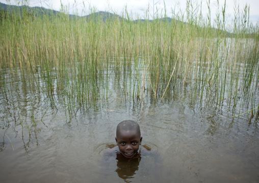 Rwandan boy having a bath, Lake Kivu, Gisenye, Rwanda