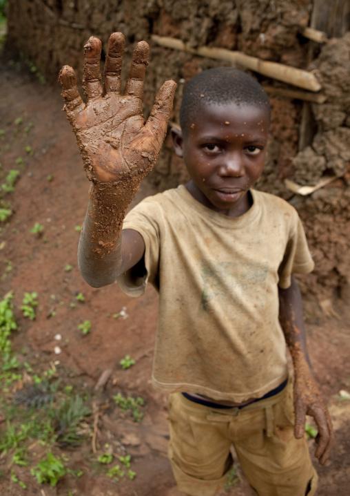 Batwa tribe boy waving hand, Western Province, Cyamudongo, Rwanda