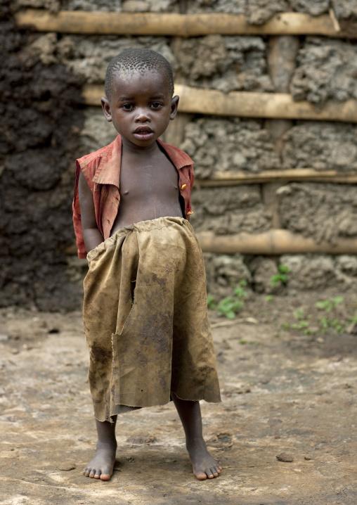 Batwa tribe boy with hands in his pockets, Western Province, Cyamudongo, Rwanda