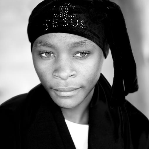 Batwa tribe woman with a jesus headwear, Western Province, Cyamudongo, Rwanda