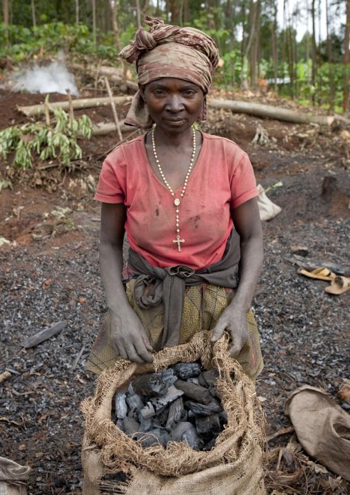 Rwandan woman selling coal, Western Province, Cyamudongo, Rwanda