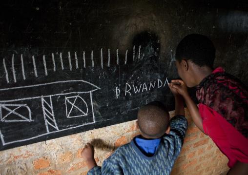 Child with her teacher in a primary school, Nyungwe Forest National Park, Gisakura, Rwanda