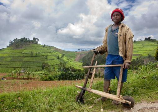 Rwandan boy with a wooden bicycle, Nyungwe Forest National Park, Gisakura, Rwanda