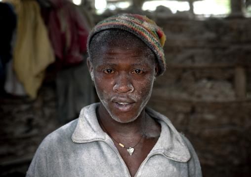 Rwandan man working in a mill, Kigali Province, Kigali, Rwanda