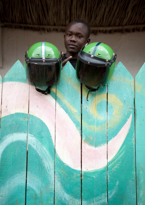 Rwandan taxi moto man with helmets, Kigali Province, Kigali, Rwanda