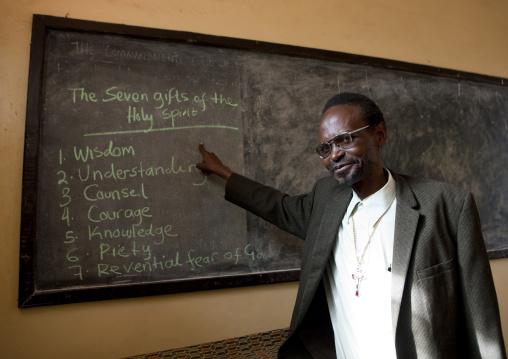 Rwandan christian religious teacher in school, Kigali Province, Kigali, Rwanda