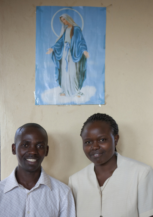 Clementine and innocent under a virgin mary poster, Kigali Province, Kigali, Rwanda