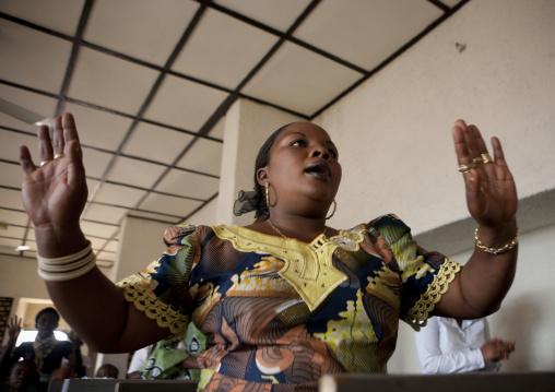 Rwandan woman praying during a sunday mass in a church, Kigali Province, Kigali, Rwanda