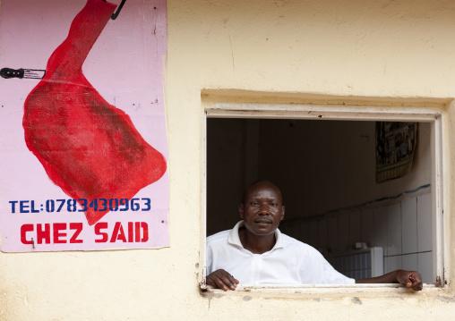 Rwandan muslim butcher in his shop, Kigali Province, Kigali, Rwanda