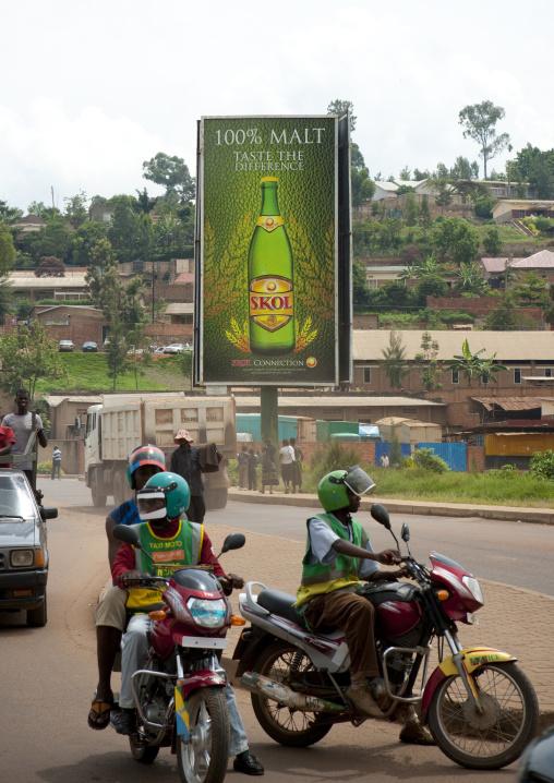 Moto taxis in front of a giant beer billboard, Kigali Province, Kigali, Rwanda
