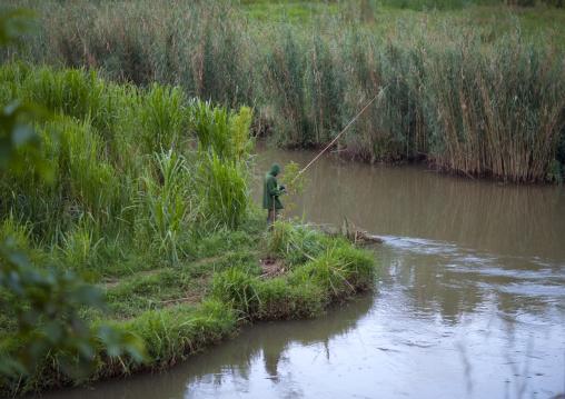 Rwandan man fishing in the countryside, Northwest Province, Rehengeri, Rwanda